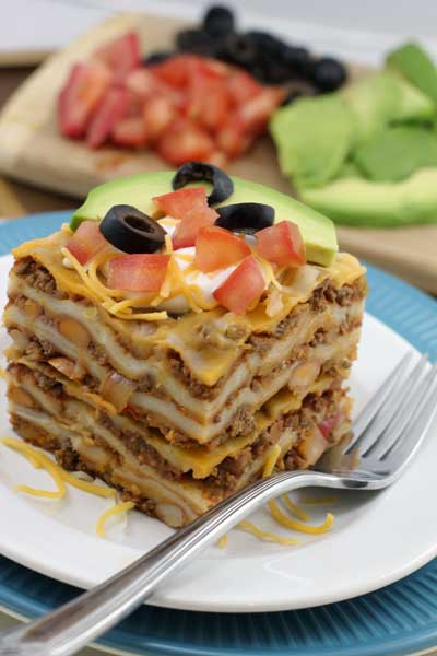 Most popular recipes from Joyful Momma's Kitchen: Layered Enchilada Casserole on plate with Fork